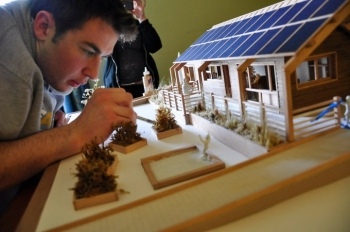 Team Massachusetts' Project Manager Spencer Culhane puts the finishing touches on the team's design model. | Courtesy of the Team Massachusetts Flickr photostream