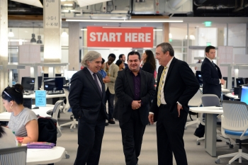 Energy Secretary Ernest Moniz, left, tours Austin Community College's ACCelerator, a high-tech learning lab that provides access to more than 600 computers for individualized learning and small group sessions. ACC's ACCelerator helps students focus on developing the in-demand technical skills needed in growing local industries, including in the energy sector. Secretary Moniz was joined by a group of students and school administrators. | Photo by Derek Posey, ACC.