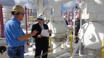 Energy Secretary Ernest Moniz, center, asks questions to guide Tony DeVille, left, during a tour of the meter skid at Big Hill Strategic Petroleum Reserve near Houston, Texas. | Photo by Matthew Gaubert, Energy Department.