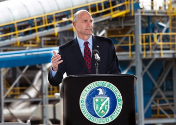 """Under Secretary for Nuclear Security Thomas D'Agostino addresses an audience of about 150 people during the ribbon-cutting ceremony for the SRS Biomass Cogeneration Facility. """"Projects like the SRS biomass facility are helping to deliver energy efficiency savings that benefit both taxpayers and the environment. Hundreds of people were put to work building this new facility that will save money, dramatically reduce emissions at the Savannah River Site and help the Department to achieve our energy saving goals,"""" D'Agostino said."""