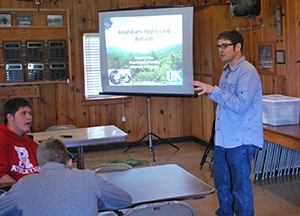 Dr. Steven Price, University of Kentucky Department of Agriculture/Forestry, presents habitat information to Marshall County High School advance placement ecological science students at the West Kentucky Wildlife Management Area lodge as part of a visit for the Annual Site Environmental Reports project.