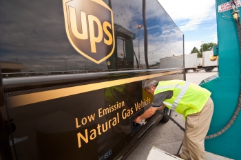 A UPS delivery truck is refueled with compressed natural gas. UPS plans to deploy 1,000 liquefied natural gas vehicles.   Photo by Pat Corkery, National Renewable Energy Laboratory