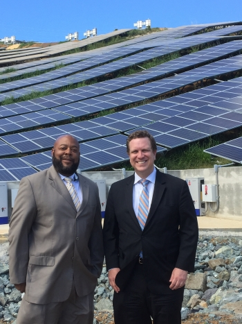 Hugo Hodge (left), Executive Director of the Virgin Islands Water and Power Authority, and Dr. Dave Danielson, the U.S. Department of Energy's Assistant Secretary for Energy Efficiency and Renewable Energy, stand in front of the 5 MW Estate Donor Solar Project on the island of St. Thomas. | Photo by Jennifer DeCesaro