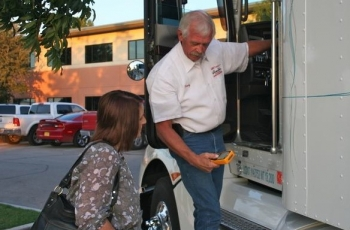Randy Anderson, a CAST Specialty Transportation Inc. driver, demonstrates the new hand-held Zonar system used to perform truck and trailer inspections at a September WIPP transportation exhibit in Carlsbad.