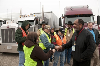 Dr. Vincent Adams congratulates crew members who prepared the first shipment of process gas equipment from the Portsmouth Site in early 2013.