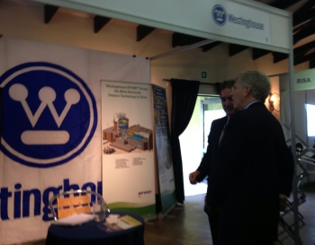 Deputy Secretary Poneman visits the Westinghouse exhibit at the Nuclear Africa Conference in Pretoria, South Africa.   Photo courtesy of the Energy Department.