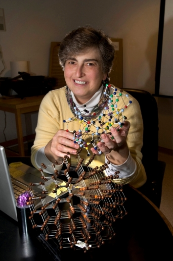 Vivian Stojanoff, a scientist at the U.S. Department of Energy's Brookhaven National Laboratory, holding a protein crystal model. Stojanoff uses x-rays at the National Synchrotron Light Source to study how atoms are arranged in protein crystals, because the arrangement affects how proteins function.