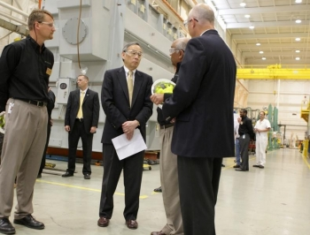 Employees of the Waukesha Electric Systems give Secretary Chu a tour of the transformer manufacturing plant. | Courtesy of Waukesha Electric Systems