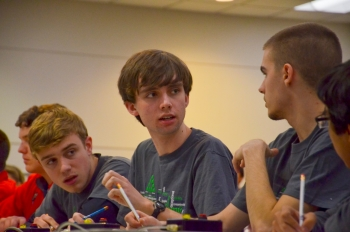 Gatton Academy of Mathematics and Science won the 2015 West Kentucky Regional High School Science Bowl competition in Paducah. Pictured, Gatton team captain Ben Guthrie (middle) discusses a question with teammate Bryan Carlson.