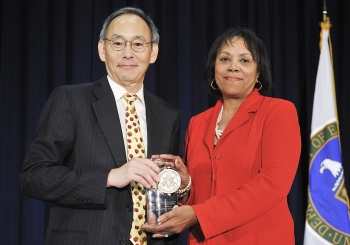 Annie Whatley, Acting Deputy Director for the Office of Minority Economic Impact with Secretary Steven Chu as she receives a Secretary of Energy Excellence Award | Photo courtesy of the Energy Department