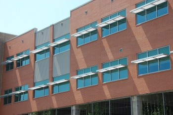 Window attachments, such as these exterior solar shades at Lake Area High School in New Orleans, Louisiana, do not include a rating system to inform consumers about their energy efficiency. Photo courtesy of National Renewable Energy Laboratory.