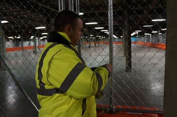 A physical security specialist with Wastren-EnergX Mission Support, LLC conducts a secured-area inspection as part of the contractor's security oversight duties at the Portsmouth Gaseous Diffusion Plant Site.