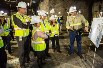 Nuclear Waste Partnership Deputy Manager of Underground Operations Mark Pearcy describes airflow in the WIPP underground to Sen. Martin Heinrich, from left, Rep. Michelle Lujan Grisham, Energy Secretary Ernest Moniz and EM Assistant Secretary Monica Regalbuto. The underground tour was part of a Jan. 9 event for WIPP's reopening.