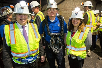 National Champion Mine Rescue Team Captain Heath Fowler, center, shared information about WIPP's mine rescue team members, who secured the 2016 national championship, with Energy Secretary Ernest Moniz and EM Assistant Secretary Monica Regalbuto during an underground tour Jan. 9.
