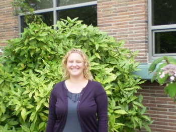 An Energy Department grant funded Autumn Salamack's new job as resource conservation manager for Kitsap County, Washington, and the energy efficient windows framed behind her. | Photo courtesy of Kitsap County, WA |