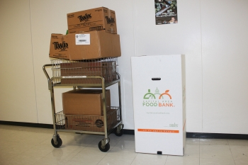 """Adam Sieminski, who works in the Energy Information Administration (EIA), brought in boxes of food for the Feds Feed Families Drive. """"The boxes were not really full of Twix bars,"""" Sieminski said. """"The cans of soup, fruits and vegetables should help provide a healthy meal for some families in need."""" 