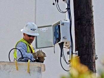 CenterPoint Energy employees are installing smart meters and automated distribution equipment in the company's electric grid in Houston, Texas. | Photo courtesy of CenterPoint Energy