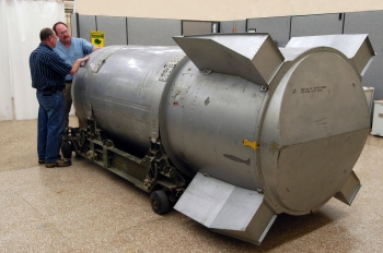 "Two Pantex Plant employees examine the final B53 bomb prior to its dismantling. | Photo Courtesy of <a href=""http://www.flickr.com/photos/nnsanews/sets/72157627937731182/"">NNSA</a>."