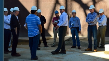 Ben Harp, center, manager of Hanford's Waste Treatment Plant Start-up and Commissioning Integration, discusses the advantages of ORP's Cold Test Facility to a group of congressional and state legislative staffers during a recent tour.