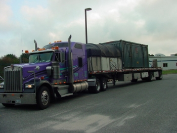 A truck carries a waste shipment from Brookhaven National Laboratory in New York. EM completed legacy cleanup activities at the site last year.