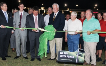 Boaz, Alabama Mayor Tim Walker, along with state representatives and community leaders, cut the ribbon for the state's solar LED light pilot project. | Photo courtesy of Lionel Green, Sand Mountain Reporter.
