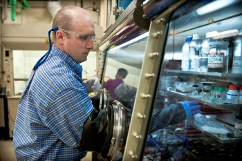 National Renewable Energy Laboratory (NREL) researcher in the lab. Image courtesy of NREL.