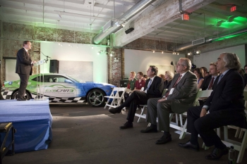 Energy Secretary Ernest Moniz (far right) watches as Assistant Secretary for Energy Efficiency and Renewable Energy David Danielson speaks during the EcoCAR 3 competition launch event in Washington, D.C. on April 24. Student teams from throughout the country will put their engineering skills to the test in a four-year competition to make the Chevrolet Camaro more sustainable. | Energy Department photo
