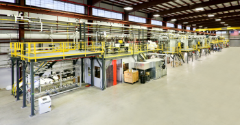 The Energy Department's Carbon Fiber Technology Facility at Oak Ridge National Laboratory provides clean energy companies and researchers with the opportunity to develop less expensive, better-performing carbon fiber materials and manufacturing processes. Pictured here is the carbon fiber conversion line with the in-line melt spinner. The melt-spinner will be used to produce new precursor fibers that will then be converted to carbon fiber. In collaboration with industrial partners, these fibers will be used to produce prototype composite parts for applications, such as automotive parts, wind turbine blades and thermal insulation. | Photo courtesy of Oak Ridge National Laboratory.