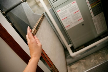 Change your furnace filter to help keep allergies at bay and keep your furnace and air conditioner running efficiently. | Photo courtesy of ©iStockphoto.com/JaniceRichard.