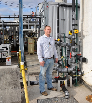 Chromium Water Treatment System Facility Manager Matt Finley stands near one of the facility's ground wells.