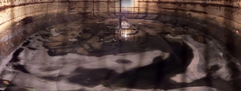 A composite image of dozens of individual-frame photos taken inside Tank C-110 provides a rare panoramic view of its interior. Portions of the tank floor and the Foldtrack waste-retrieval system are clearly visible.