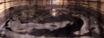 A composite image comprised of dozens of photos taken inside C-110 provides a rare panoramic view of the tank interior. Portions of the tank floor and the FoldTrack waste-retrieval system are clearly visible.