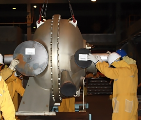 Workers guide a compressor during a lift from the former uranium enrichment cascade in the X-326 Process Building at EM's Portsmouth Gaseous Diffusion Plant in Piketon. The first shipment of the components, which were used for 60 years, was completed in January as part of cleanup operations under way at the EM facility.