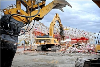 Crews demolish CPP-601, a building used during used nuclear fuel reprocessing at the Idaho Nuclear Technology and Engineering Center.