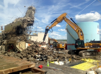Site subcontractor American DND completed demolition of the contaminated 01-14 Building in 2013.