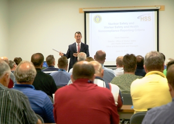 Kevin Dressman, director of the DOE Office of Worker Safety and Health Enforcement, addresses LATA Kentucky employees during a training session. The June regulatory assistance review was aimed at ensuring worker safety.