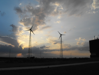 Homeowners who install small wind turbines similar to these can qualify for tax credits.   Photo courtesy of Wind Utility Consulting