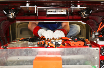 A team member from North Carolina State University prepares for high voltage testing on their battery pack. The team has built a series hybrid. | Photo courtesy of EcoCAR 2.
