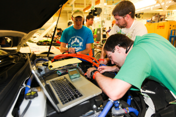 The University of Tennessee - Knoxville team verifies the proper wiring for gear selection before their vehicle is inspected for safety. All teams must pass a safety technical inspection before competing in any driving events. | Photo courtesy of EcoCar 2.