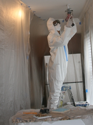 Kristan Castro weatherizes a northern Virginia home.   Photo courtesy EDGE Energy