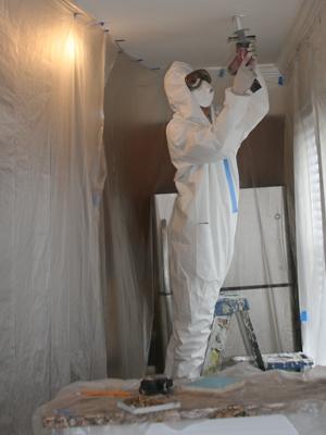 Kristan Castro weatherizes a northern Virginia home. | Photo courtesy EDGE Energy