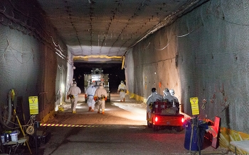Workers move waste for emplacement underground at WIPP on Jan. 4.