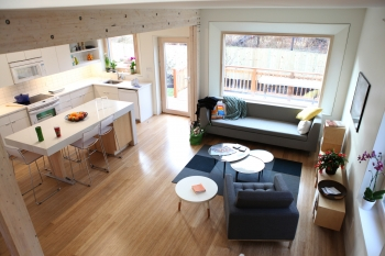 """Large south-facing windows allow for ample light without heating up the house. For more photos of the Empowerhouse ribbon cutting, <a href=""""/node/580963"""">view our photo gallery</a>. 
