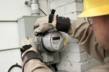 An employee installs a smart meter as part of a smart grid initiative by EPB. The project is supporting 390 jobs in the Chattanooga area. | Photo courtesy of EPB