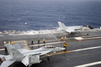DOE, USDA, and Navy are working with private industry to produce advanced drop-in biofuels that can be used by the Department of Defense and the private transportation sector.   Photo courtesy of U.S. Navy.