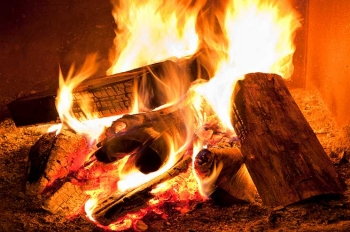 A warm fireplace can save you energy and money with proper maintenance.   Photo courtesy of ©iStockphoto.com/Pgiam.