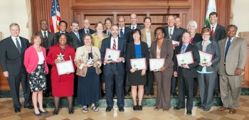 Members of the Interagency Five-Year Review Workgroup gather for a photo after receiving the Excellence in Partnership award from the EPA's Office of Solid Waste and Emergency Response on Sept. 18. The award recognizes the workgroup's collaborative effort in developing tools for the five-year reviews. DOE members of the workgroup include, front row, fourth from left, Gerald C. DiCerbo; fifth from left, Letitia O'Conor; and seventh from left, Cliff Carpenter. Also pictured are, first row, first from left, EPA Associate Deputy Administrator Lisa Feldt, a former EM employee; far right, EPA Office of Solid Waste and Emergency Response Assistant Administrator Mathy Stanislaus; back row, first from left, EM Office of Site Restoration Associate Deputy Assistant Secretary William Levitan; and second from left, Office of Health, Safety and Security's Office of Sustainability Support Director Josh Silverman.