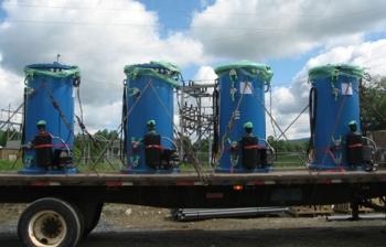 Seven-foot tall cylinders equipped with flywheel technology (shown above) will make up Beacon Power's energy storage plant in Stephentown, N.Y. The company received a $43 million loan guarantee from the Energy Department to build the plant. | Photo courtesy of Beacon Power Corporation