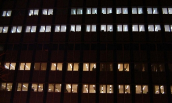 When this photograph was taken, the upper floors of Wisconsin's Department of Transportation were using a new lighting plan from EPS, while the lower ones were still using the pre-audit lighting scheme. | Photo Courtesy of Energy Performance Specialists, LLC