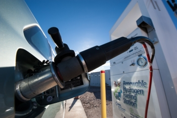 A fuel cell vehicle is refueled with hydrogen at the National Renewable Energy Laboratory's National Wind Technology Center.   Photo by Dennis Schroeder, National Renewable Energy Laboratory